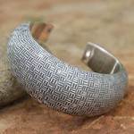 Sterling silver cuff bracelet, 'Woven Illusion'