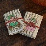 Handmade paper journals, 'Lakshmi and Ganesha' (pair)