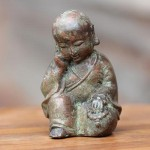 Sleepy Baby Buddha Statue by Elayanti
