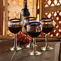 Blown glass wine glasses, 'Sapphire Globe' (set of 4)