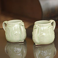 Celadon ceramic mugs, 'Elephant Greeting' (pair)