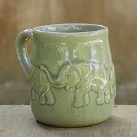 Celadon ceramic mug, 'Jade Elephant Parade'
